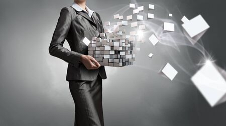 solving: Close view of businesswoman shows cube as symbol of modern technology Stock Photo