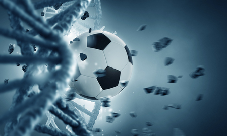 Biochemistry concept with DNA molecule broken with soccer ball 스톡 콘텐츠