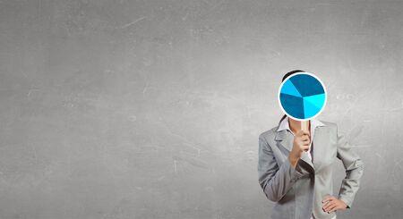 hidden success: Businesswoman hiding her face behind diagram mask