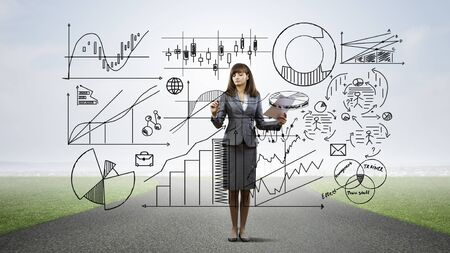 achieving: Businesswoman drawing business development sketches for success achieving on screen