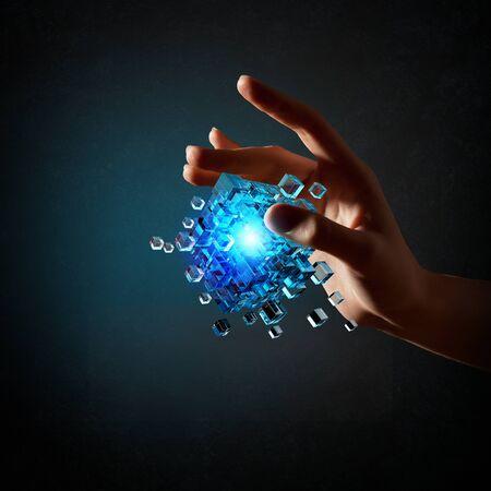 outside the box thinking: Businessman hand take digital cube as thinking outside the box concept Stock Photo