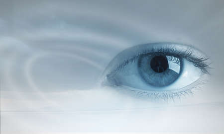 woman eyeball: Beautiful female eye in sky as vision concept