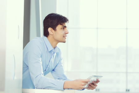 real leader: Successful and confident businessman with tablet in modern building interior Stock Photo