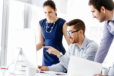 Business people working and discussing in modern office