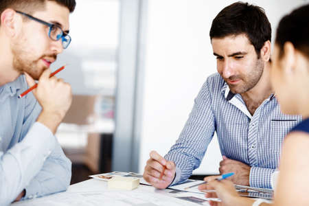 business relationship: Business people working and discussing in modern office