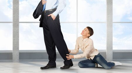 stay home work: Close up of legs of husband going away and his wife praying him to stay