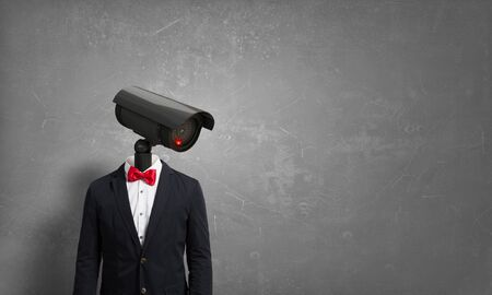 to privacy: Portrait of camera headed man in suit as security concept