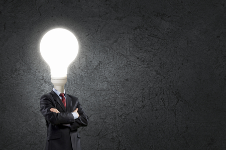 careerist: Businessman with light electric bulb instead of head as symbol of bright idea