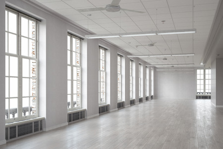 new building: Large spacious room with windows as office interior Stock Photo
