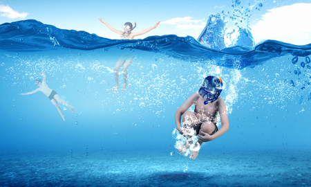 kids swimming: Kid boy of school age in diving mask jumping in water Stock Photo