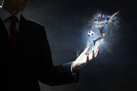 male palm: Soccer player with ball in action in male palm