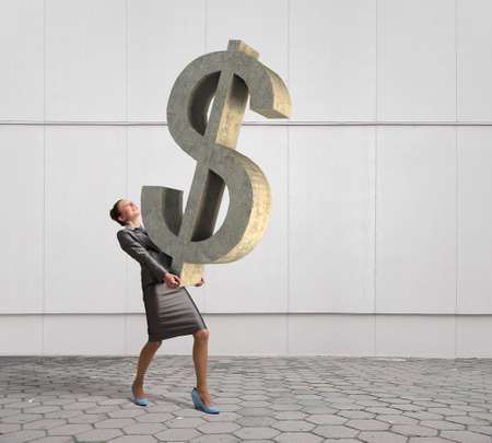 account executive: Young businesswoman holding big dollar symbol in hands Stock Photo