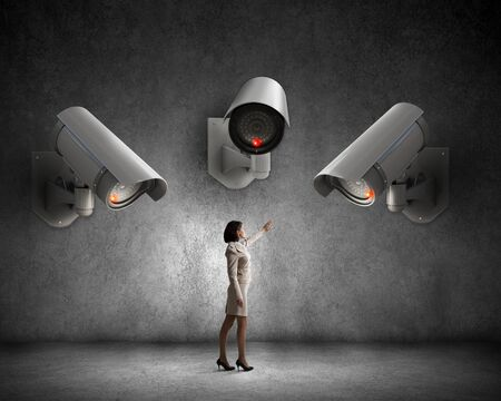 keep an eye on: Young woman in room under CCTV camera control