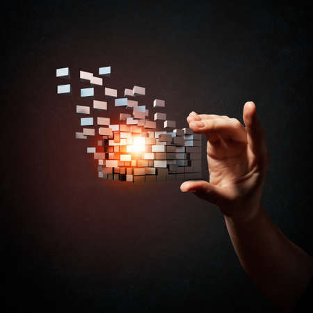 technology symbols metaphors: Businessman hand take digital cube as thinking outside the box concept Stock Photo