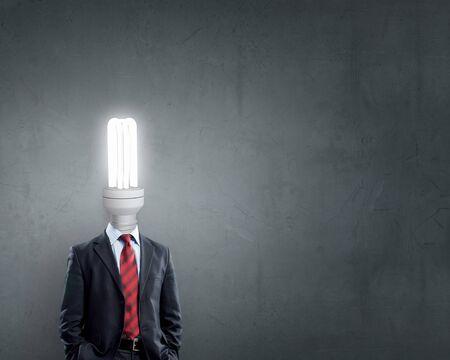 careerist: Businessman with light electric bulb instead of head as symbol of bright idea