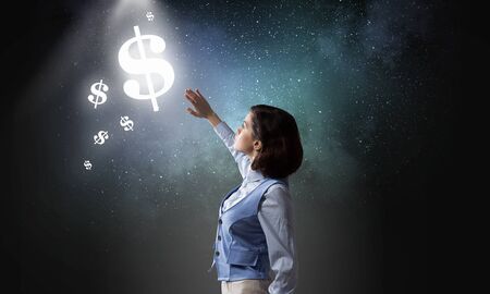 blinded: Young businesswoman blinded with light of glowing dollar sign Stock Photo