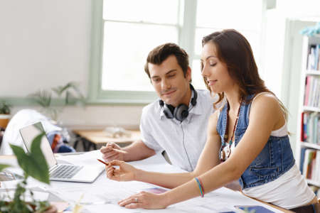 creative idea: Start-up Team of two young people in office Stock Photo