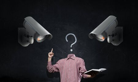 unknown men: Headless businessman in room under CCTV camera control Stock Photo