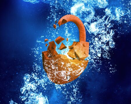 rusted: Rusted opened padlock under blue clear water