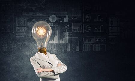 careerist: Businesswoman with light electric bulb instead of head as symbol of bright idea Stock Photo