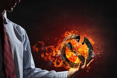 hands fire passion: Prohibition broken symbol in fire flames in palm on dark background