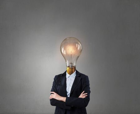 great suit: Businessman with light electric bulb instead of head as symbol of bright idea