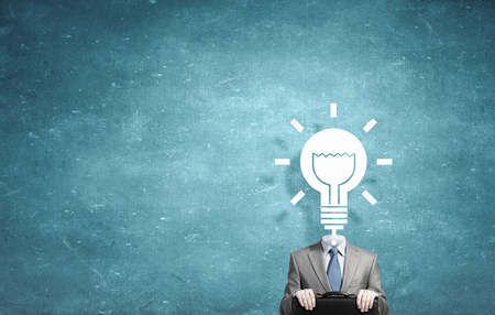careerist: Businessman with light bulb instead of head as symbol of bright idea Stock Photo