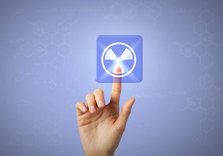 radioactivity: táctil de la mano con el icono del dedo radiactividad en la pantalla