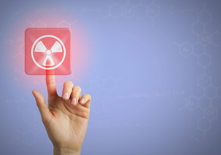 radioactivity: Hand touching with finger radioactivity icon on screen