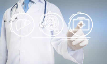 a medical technology: Close view of male doctor touching icon of media screen