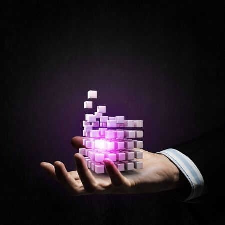 technology symbols metaphors: Businessman hand shows digital cube as thinking outside the box concept
