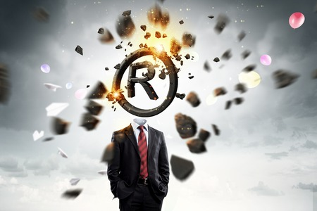 destructed: Businessman with trademark sign instead of his head