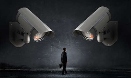 keep an eye on: Young scared man in room under CCTV camera control