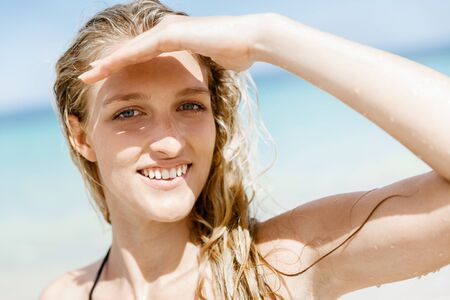 Portrait of young pretty woman at the beach