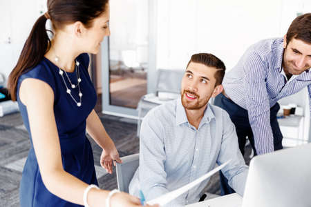 meeting table: Business people working and discussing in modern office