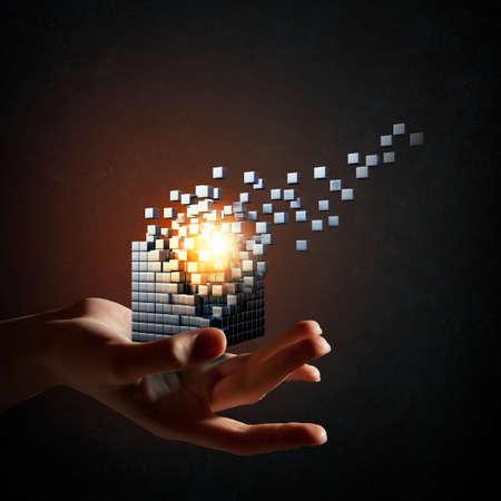 thinking outside the box: Businessman hand take digital cube as thinking outside the box concept Stock Photo