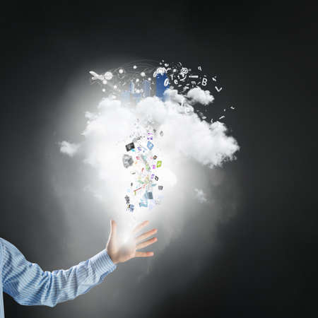 cloud computer: Hand of businessman and white cloud with flying icons Stock Photo