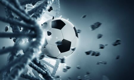 Biochemistry concept with DNA molecule broken with soccer ball Фото со стока