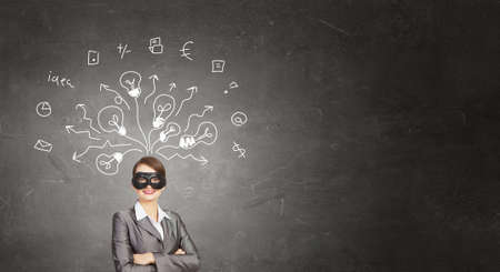hidden success: Young businesswoman with black mask on face