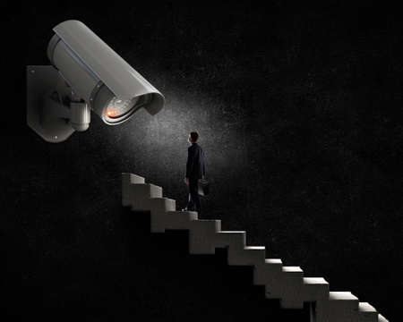 Young scared man in room under CCTV camera control Stock Photo - 54110931