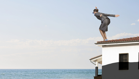 businesswoman suit: Young businesswoman in suit and mask ready to jump in water
