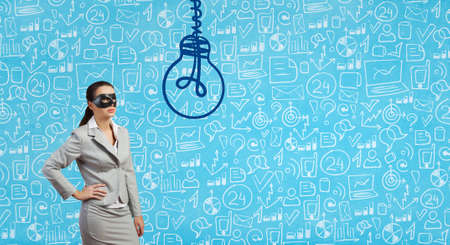 Young thoughtful businesswoman with black mask on face Stock Photo