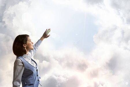 blinded: Young businesswoman blinded with light going from above