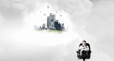 thought cloud: Pensive businessman sitting in chair and thought cloud above
