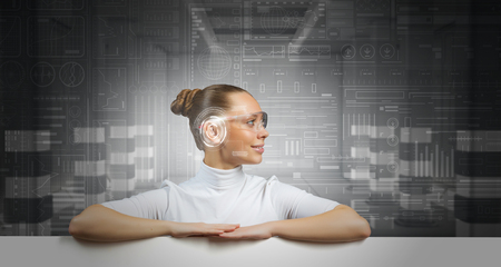 telecommunicate: Cyber woman in glasses in virtual interface interior with white banner Stock Photo