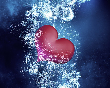 under heart: Red love heart under clear blue water