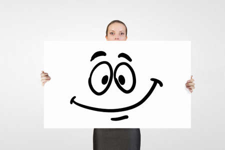 smilie: Young businesswoman showing banner with drawn smilie