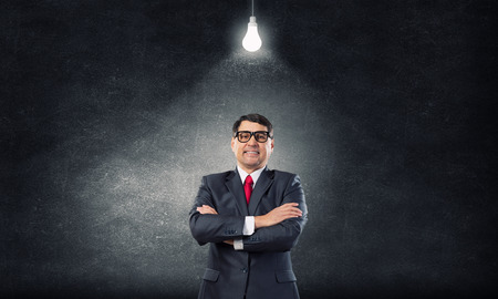 mani incrociate: Experienced businessman in glasses standing with hands crossed on chest Archivio Fotografico