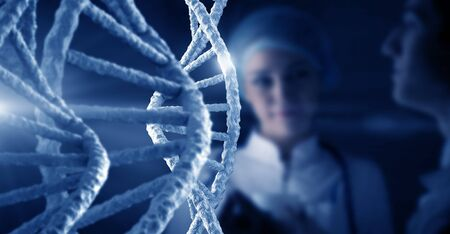 Woman scientist at media background of DNA molecule