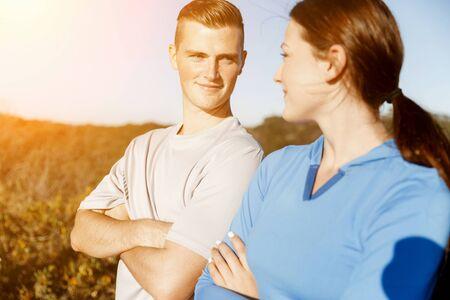 sportwear: Young couple on beach wearing sportwear
